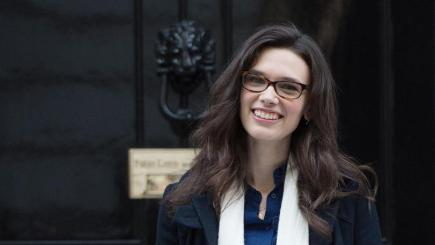 Model Rosie Nelson delivers a petition to Downing Street