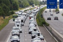Cars are stuck in a traffic jam shortly before reaching the Rader high bridge at the A7 motorway near Rendsburg, Germany, 28 July 2013