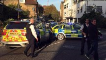 Police at the scene where a teenager was stabbed to death in south London