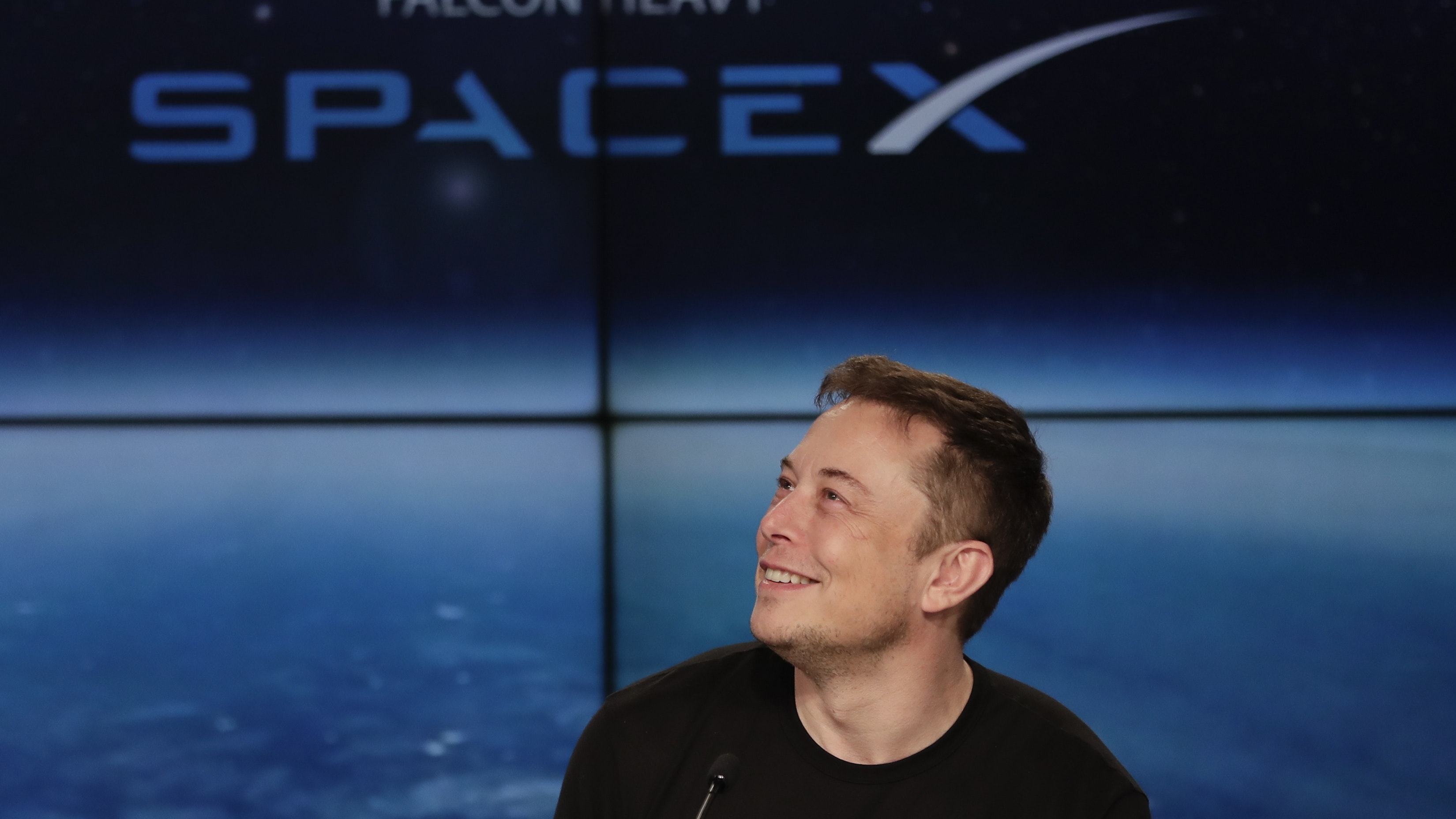 Musk s space company signs up passenger to fly around moon for Flying spaces