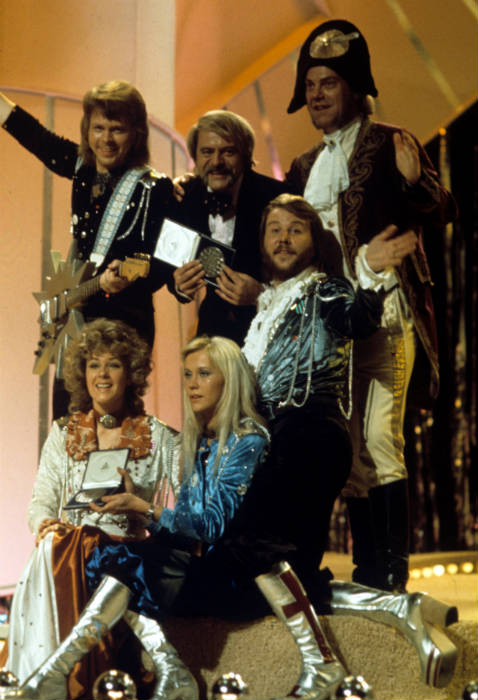 Conductor Sven-Olof Walldoff, pictured with ABBA and manager Stig Andersson, dressed as Napoleon for the performance.