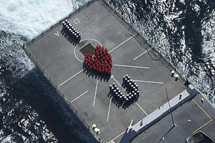 The crew of the Royal Navy destroyer HMS Daring sending a Valentine's message to their loved ones back home (MoD/PA)