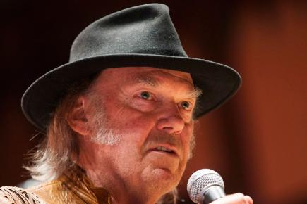 Neil Young wearing hat with microphoneNeil Young Hat