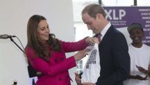 The Duke and Duchess of Cambridge are presented with a baby grow for their second child during their visit to urban youth charity XLP at Christ Church, Gypsy Hill, south London