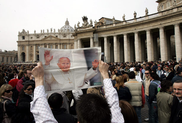 A newspaper pictured in St Peter's Square reports the news of the pope's death