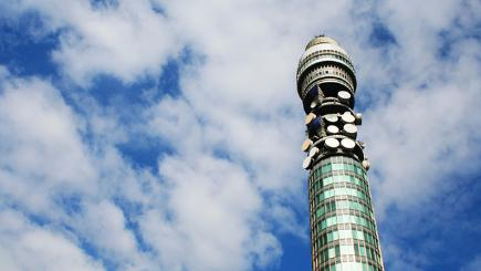 The BT Tower in London against a blue sky with a smattering of clouds