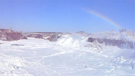 Niagara Falls freezes to form mesmerising ice scene framed with stunning rainbow