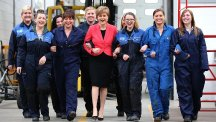 First Minister Nicola Sturgeon meets apprentice mechanics at an Arnold Clark training centre in Glasgow as she makes an announcement to mark the start of Scottish Apprenticeship Week. (PA)