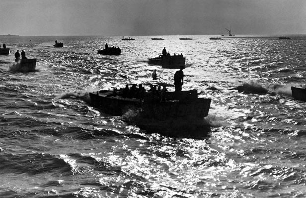 Assault Landing Crafts carrying British Royal Marines, form up in the English Channel on the night of 5th June 1944.