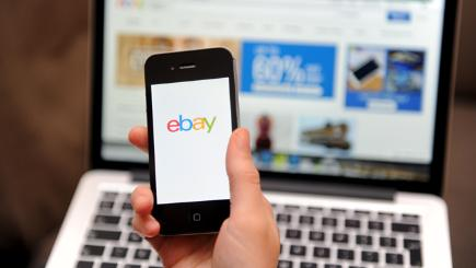 eBay on phone and laptop