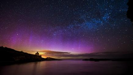 Northern lights over Bathing House in Howick, Northumberland