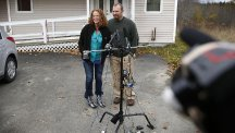 Kaci Hickox and her boyfriend Ted Wilbur speaks to the media outside their home in Fort Kent (AP)