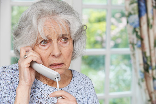 Woman on the phone looking unhappy