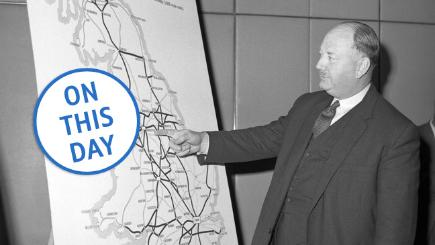 Dr Richard Beeching points out details on a large map, showing how British Rail trunk routes may look in 1984.