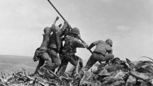 American soldiers raise flag on Iwo Jima volcano