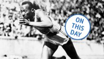 Jesse Owens breaks the 100m tape to win the first of his four gold medals at the Berlin Olympics.