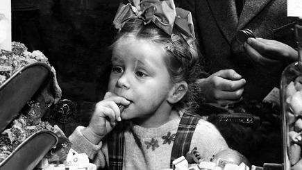 Child eating sweets in 1953