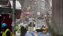 A collapsed crane lies on the street in the Tribeca neighbourhood (AP)