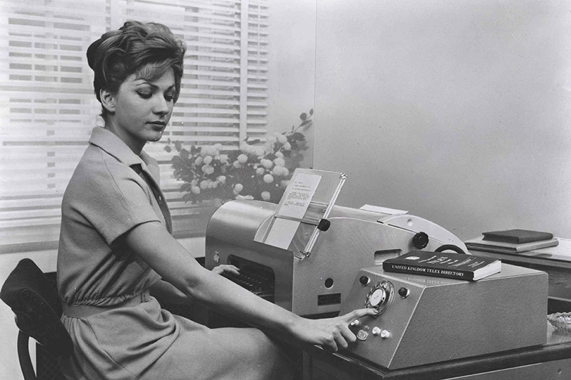 Operator at a telex machine position. 1959.