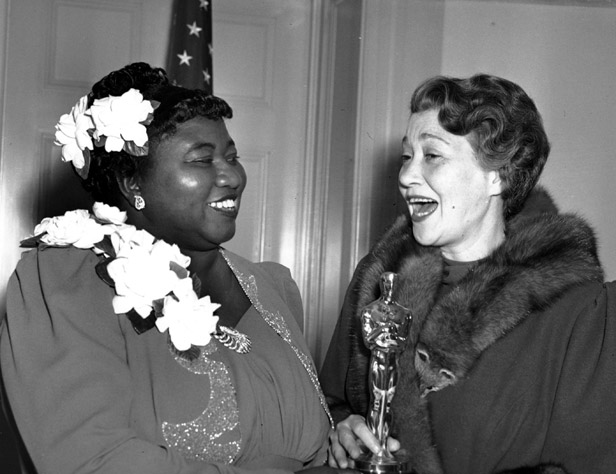 Hattie McDaniel receives her Academy Award from actress Fay Bainter.
