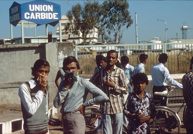 Anxious locals wait outside the Union Carbide factory, Bhopal