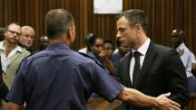 Oscar Pistorius is led out of court in Pretoria (AP)