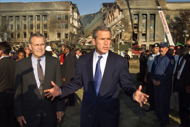 President George W. Bush surveys the damage at the Pentagon.