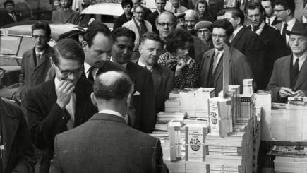 People queue at a Leicester Square bookshop to buy a copy of Lady Chatterley's Lover.