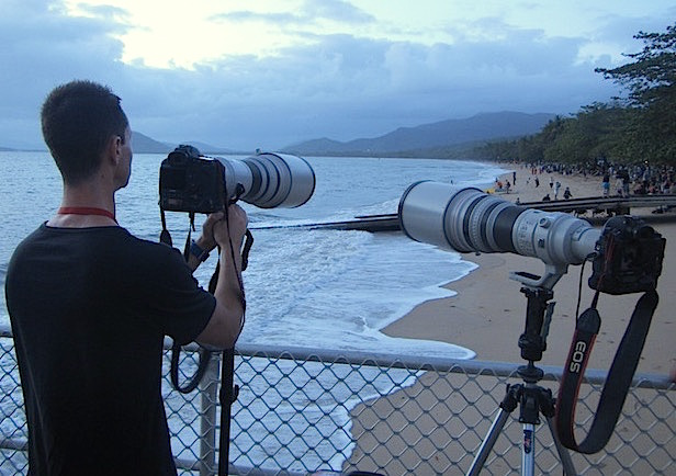 Person filming with DSLR with long lens. Copyright Jamie Carter