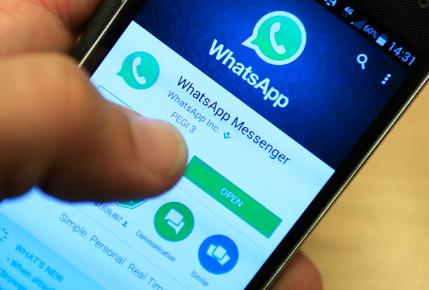 Phone with WhatsApp app being installed