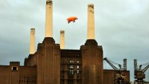 A giant inflatable pig flies above Battersea Power Station during a recreation of the cover of the Pink Floyd album Animals