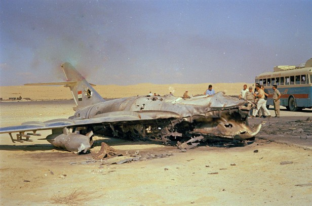 An Egyptian warplane lays destroyed on the ground following an attack by Israeli aircraft.
