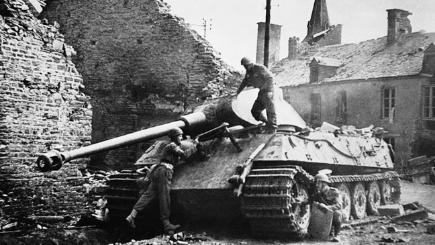 British soldiers examine a new 65-ton German super-tank 1944