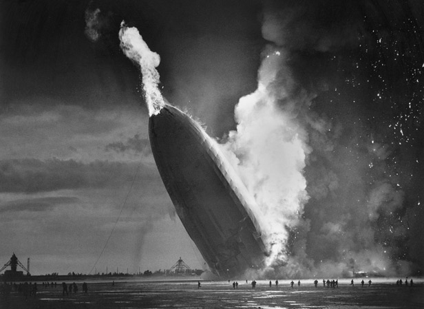 The Hindenburg plummets tail first towards the ground at Lakehurst, New Jersey.