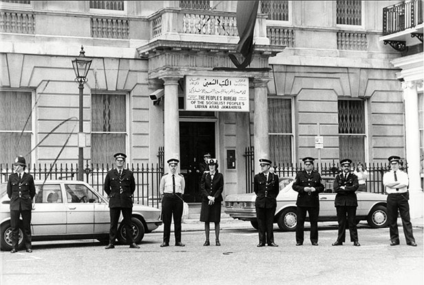 Police stand guard outside the embassy.