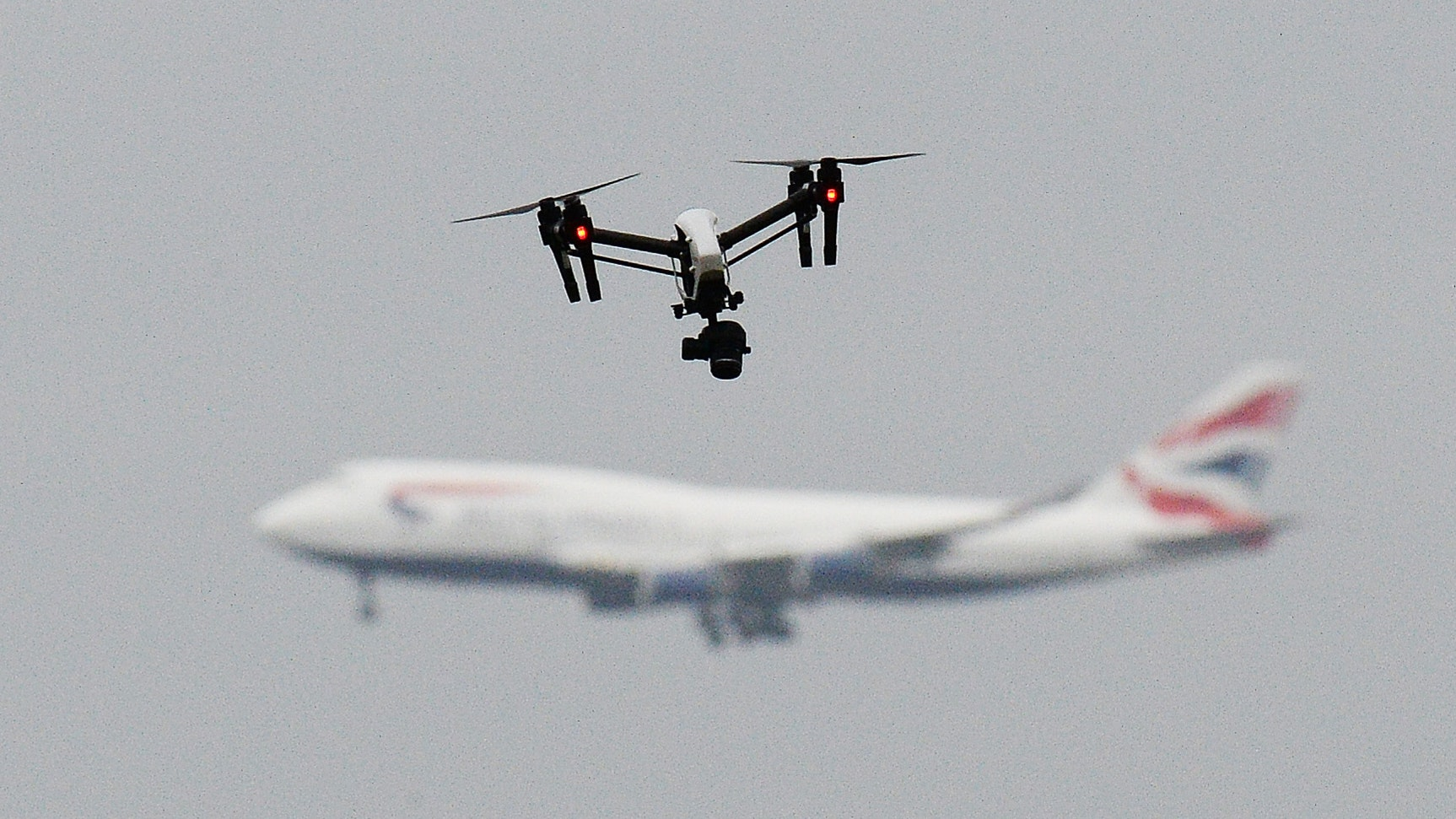 London's Heathrow Airport halts departures for drone report