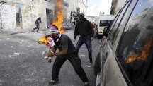 Palestinian youths clash with Israeli police after Moataz Hijazi was shot in east Jerusalem. (AP)