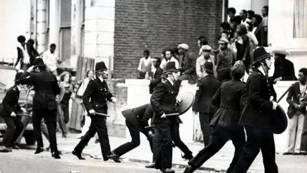 Police with truncheons and bin lids on the streets of Notting Hill.
