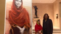 Schoolgirl Nobel Peace Prize winner Malala Yousafzai with artist Nasser Azam at the unveiling of a new portrait entitled Malala, at the Barber Institute of Fine Arts, Birmingham.