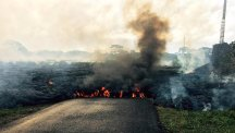 The lava flow from Kilauea volcano crosses a street near the town of Pahoa (US Geological Survey/AP)