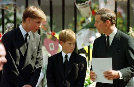 Prince Harry aged 12 with his brother Prince William and father Prince Charles looking at floral tributes after the death of his mother Princess Diana