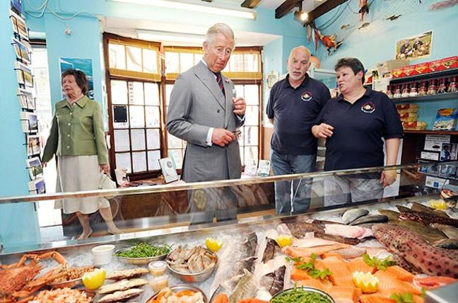 Prince Of Wales Meets Staff At Gills Plaice Fish Shop During A Visit To Aberdyfi