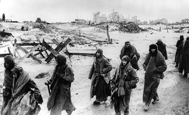 Captured German soldiers make their way in the bitter cold through the ruins of Stalingrad