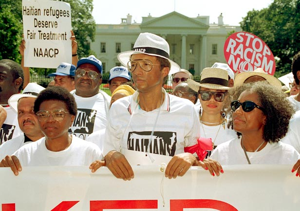 Ashe leads a protest against the Bush administration's policy on Haiti in September 1992.