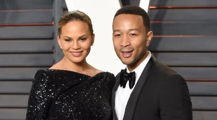 John Legend and Chrissy Teigen help daughter throw first pitch