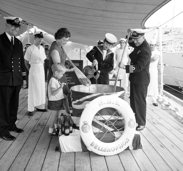 HMS Belfast's last rum issue was poured into a Christmas pudding for Portsmouth shore establishment HMS Bellerophon.