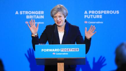 UK's May promises voters immigration curbs, fairer society
