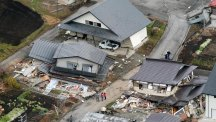 Houses collapsed like matchwood after a strong earthquake hit Hakuba in the Nagano region of central Japan (Kyodo News/AP)