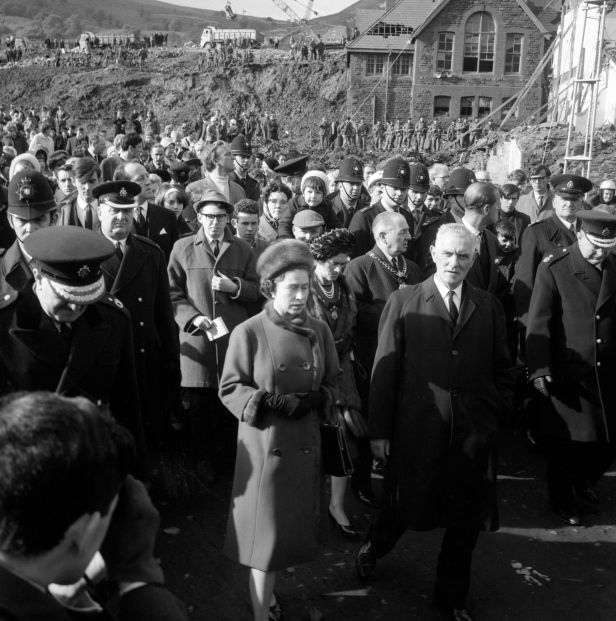 The Queen and Prince Philip visit the scene of the tragedy on October 29.