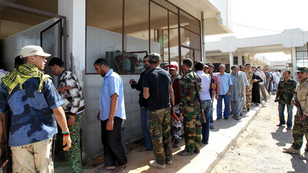 Libyan people waiting to see the body of Muammar Gaddafi outside a market place in Misrata, Libya.